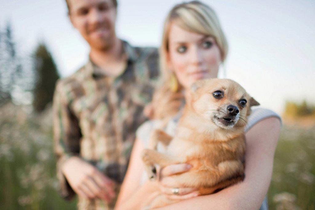 Stock Photo: 1889R-72004 a couple with their dog, edmonton alberta canada