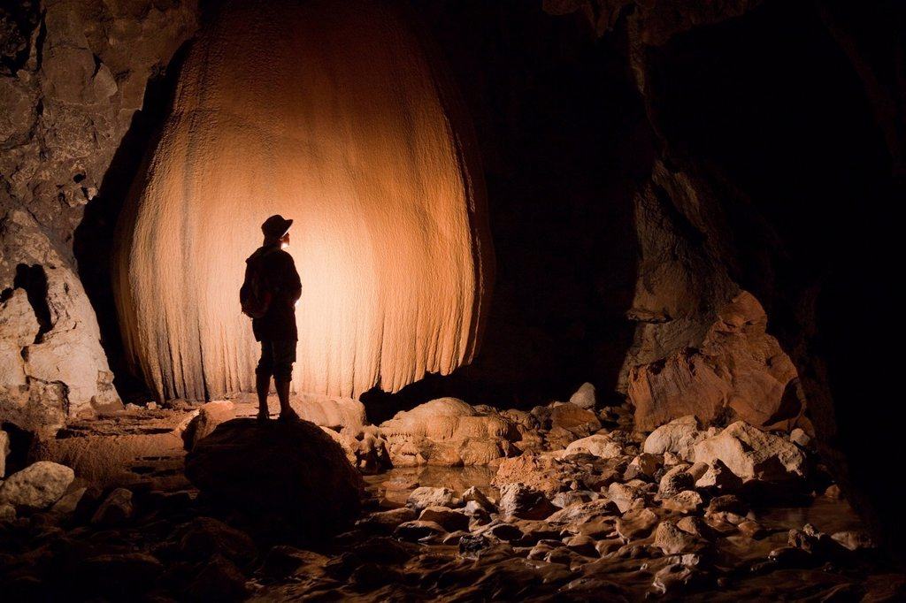 A Filipino Tour Guide Holds A Lantern Inside Sumaging Cave Or Big Cave Near Sagada, Luzon Philippines : Stock Photo