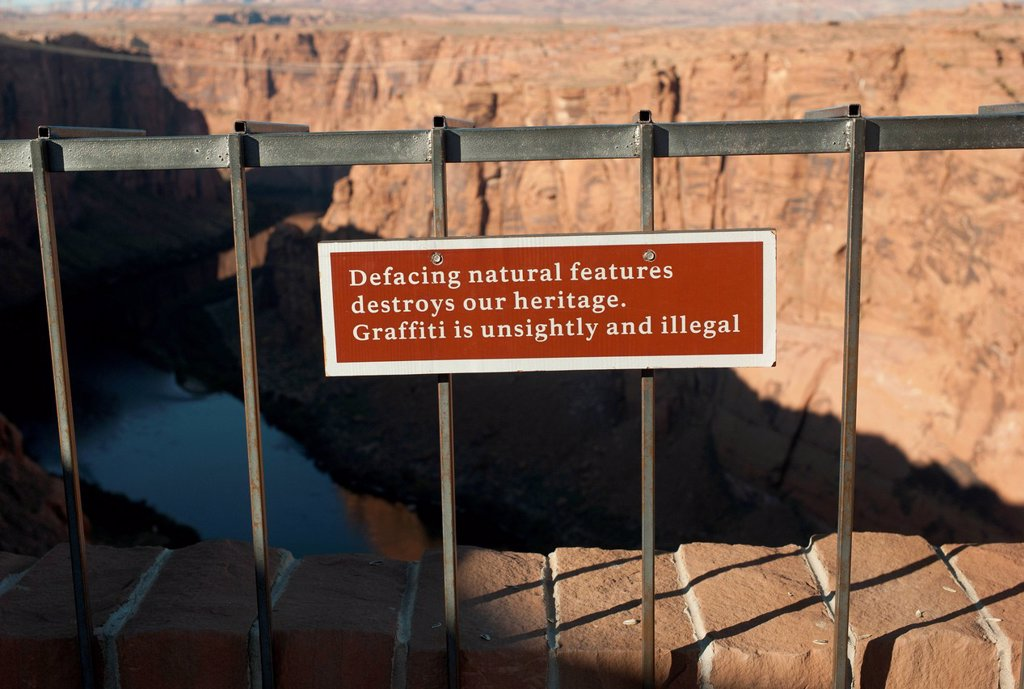 Stock Photo: 1889R-73239 A Posted Sign About Graffiti Along The Colorado River, Arizona United States Of America