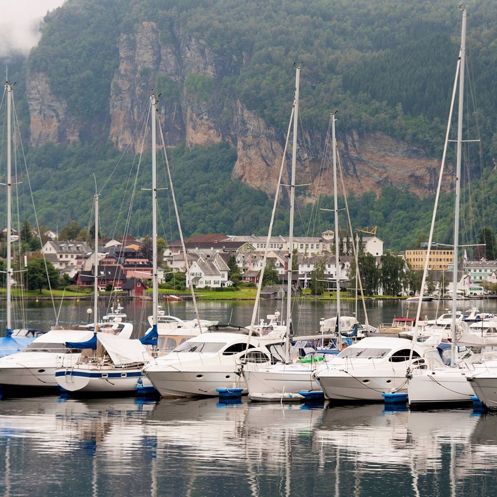 Sailboats in the harbour of hardangerfjord, hardangervidda norway : Stock Photo
