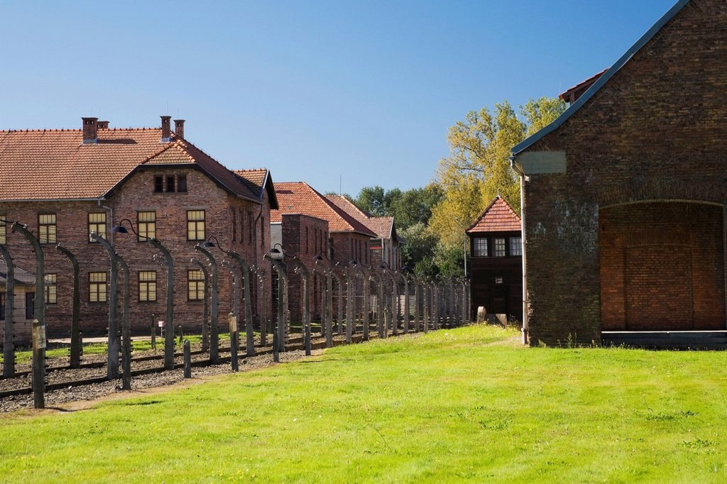 Stock Photo: 1889R-73484 Barb wire fences and buildings inside the auschwitz i former nazi concentration camp, auschwitz poland