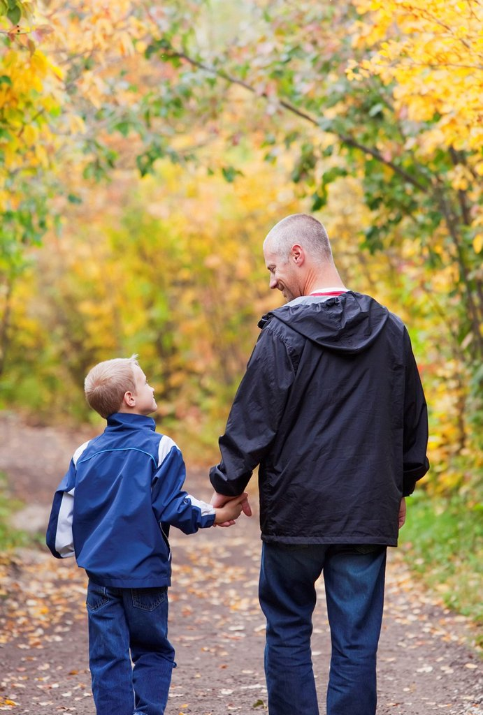 Stock Photo: 1889R-73582 Father And Son Walking On A Path In A Park In Autumn, Edmonton Alberta Canada