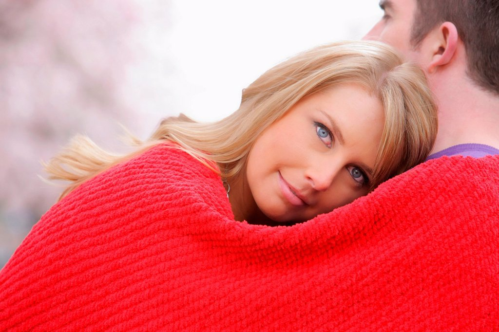 Couple Huddled In A Red Blanket, Portland Oregon United States Of America : Stock Photo