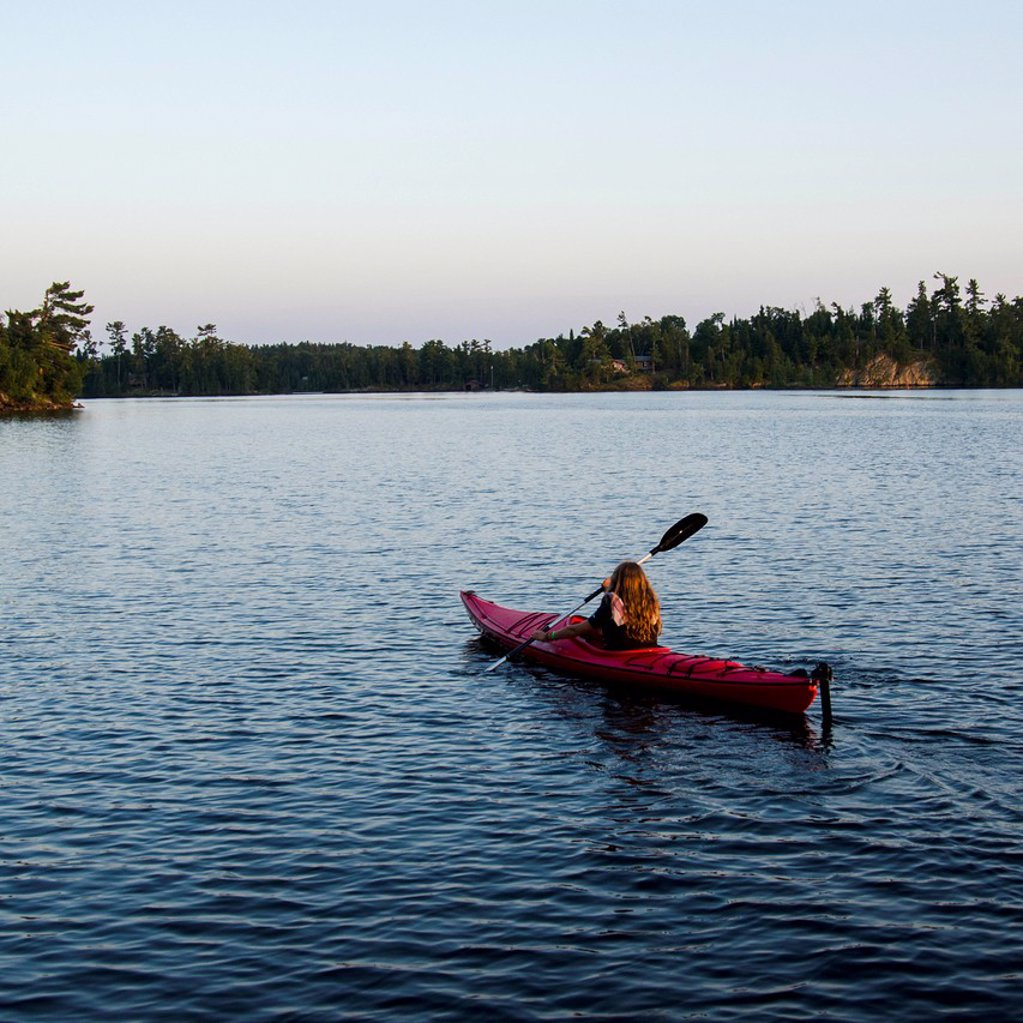 Stock Photo: 1889R-74477 A girl in a kayak, lake of the woods ontario canada