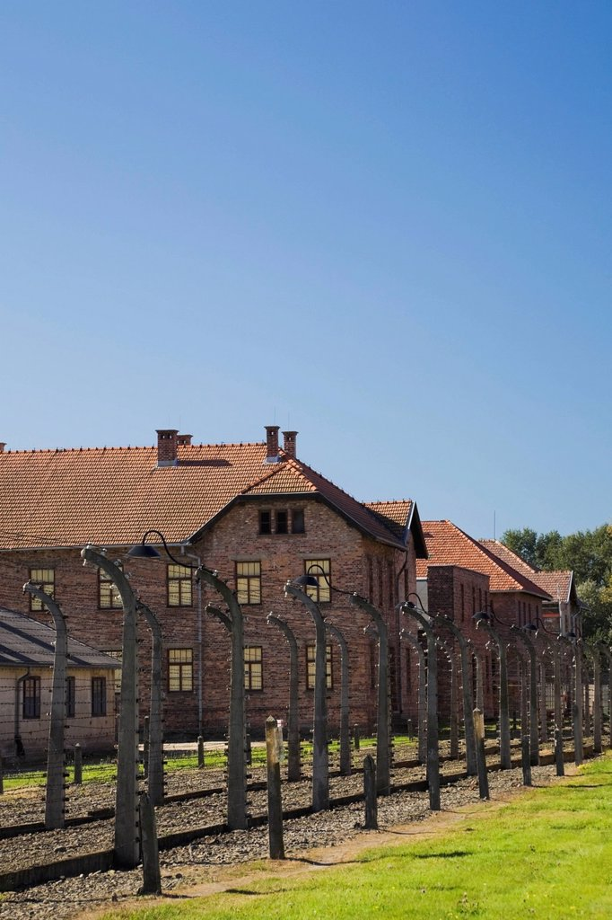 Stock Photo: 1889R-74542 Barb wire fences and buildings inside the auschwitz i former nazi concentration camp, auschwitz poland