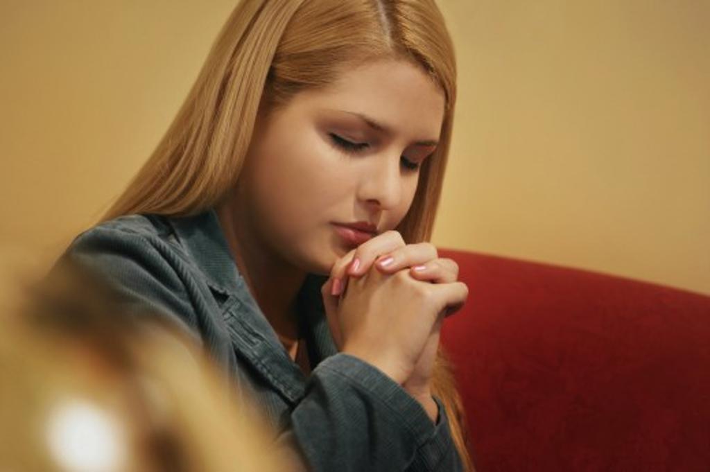 Teenager prays : Stock Photo