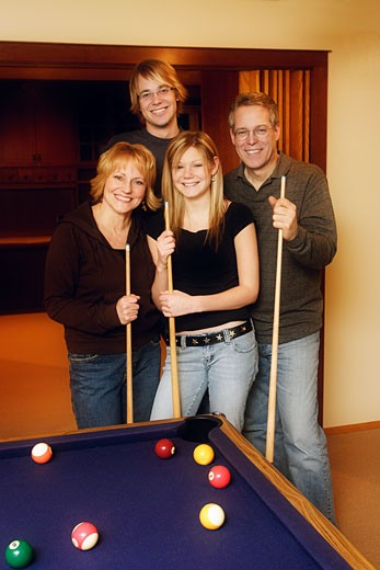Family playing a pool game : Stock Photo