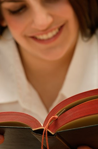 Woman reading a book : Stock Photo
