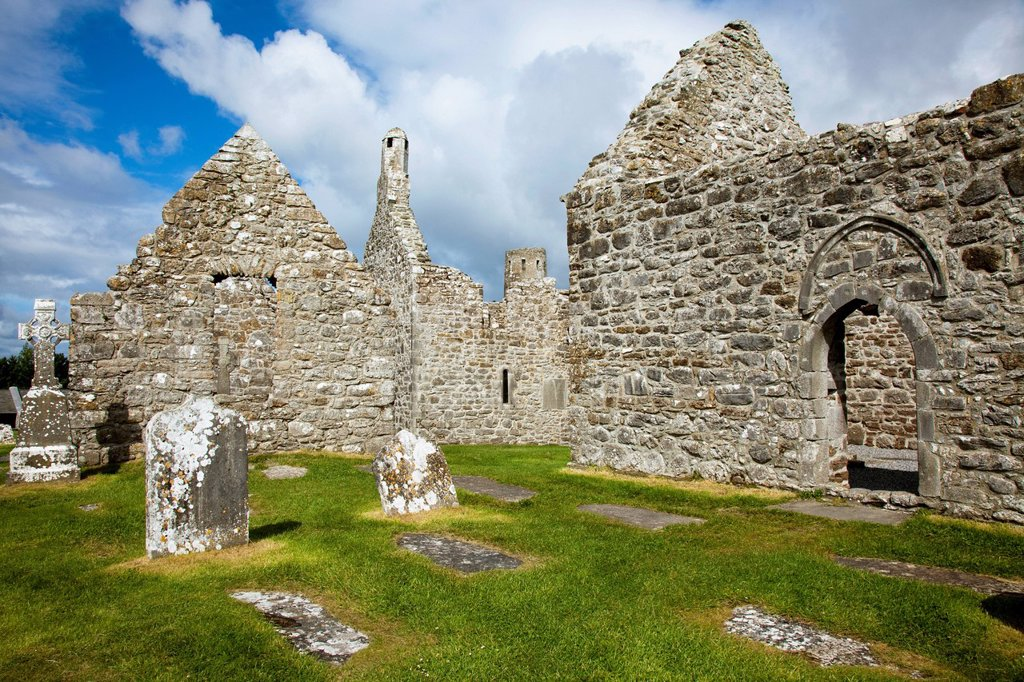 Tombstones In A Cemetery And An Old Cathedral, Clonmacnoise County Offaly Ireland : Stock Photo