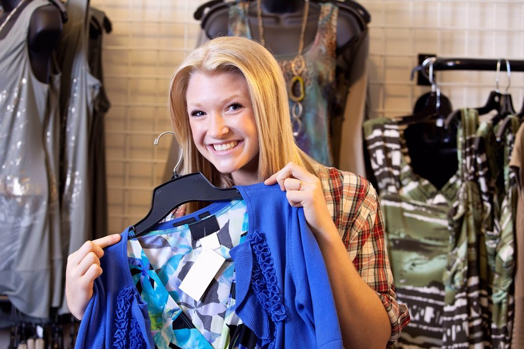 a young woman shopping for clothing at a boutique, edmonton, alberta, canada : Stock Photo