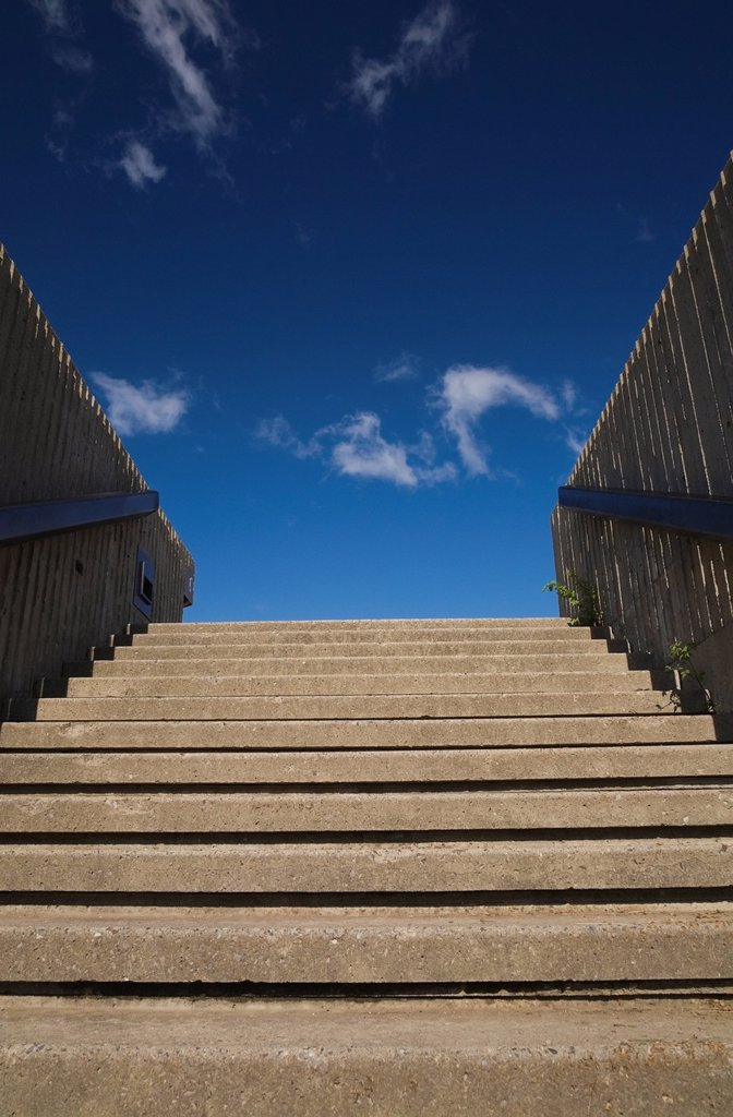 Cement Steps Leading Up To A Blue Sky And Clouds, Montreal Quebec Canada : Stock Photo