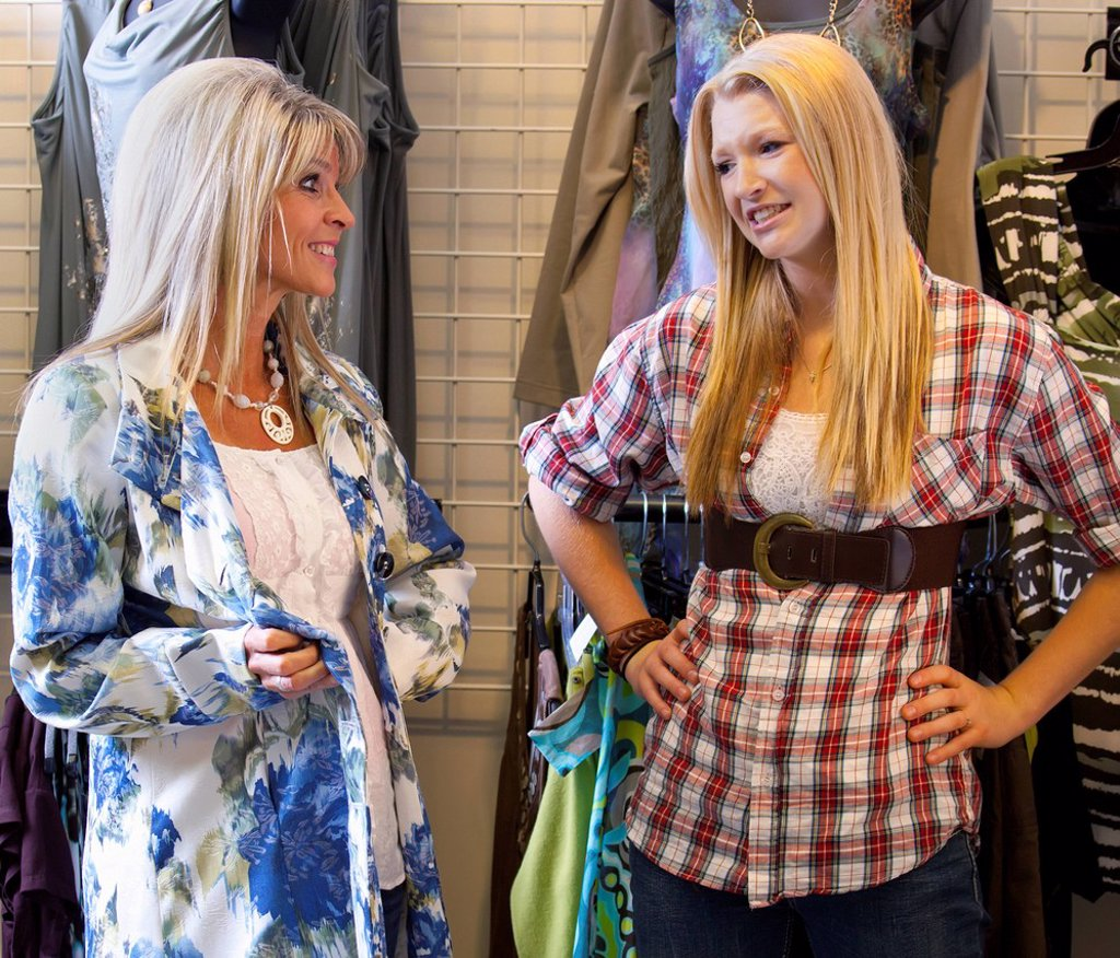 mother and daughter shopping for clothes at a boutique, edmonton, alberta, canada : Stock Photo