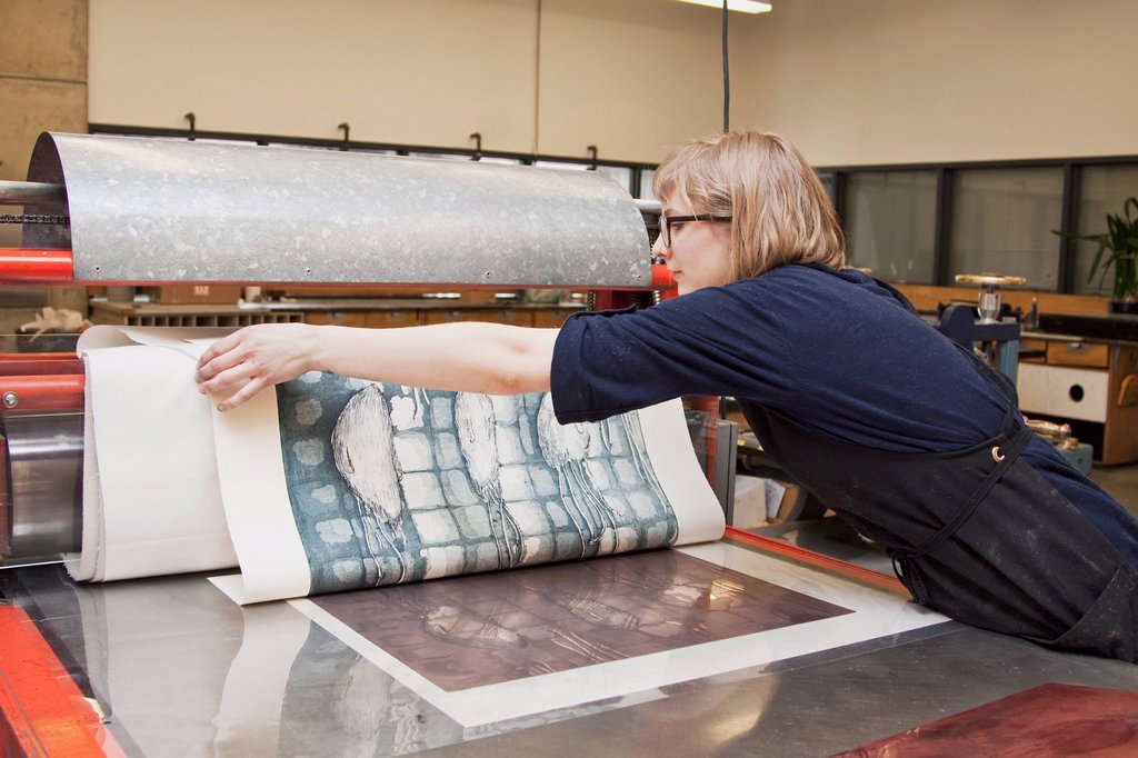 Stock Photo: 1889R-77501 Young female art student creating prints in studio, edmonton alberta canada