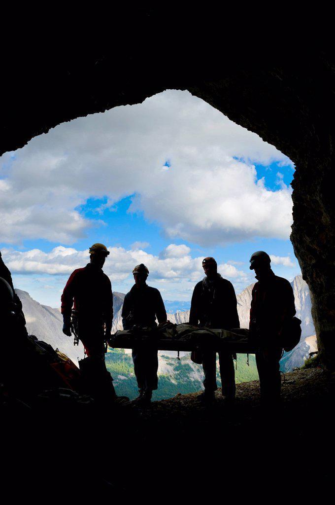Stock Photo: 1889R-77725 Participant´s silhouettes at a gargantua cave rescue, blairmore alberta canada