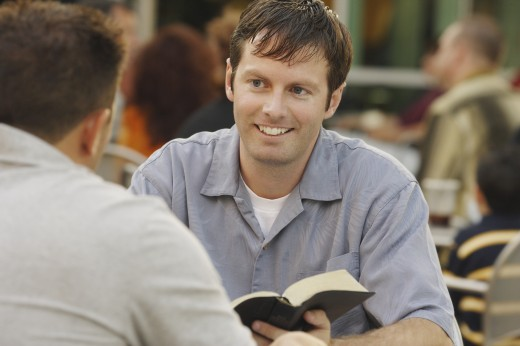 Stock Photo: 1889R-7777 Man sharing from a book