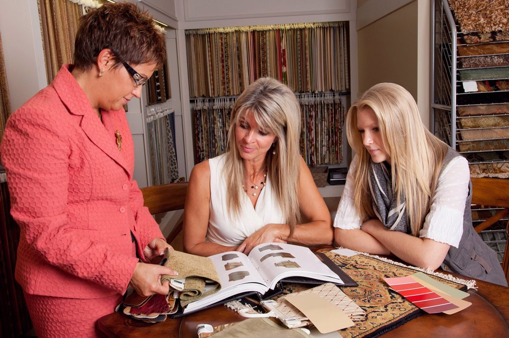 Stock Photo: 1889R-78006 mother and daughter discussing colours and samples for remodelling of home with an interior designer, edmonton, alberta, canada