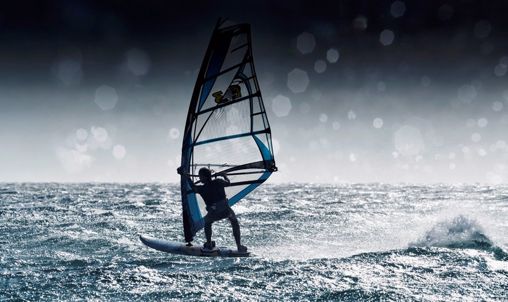 Windsurfing with water drops on camera lens, tarifa cadiz andalusia spain : Stock Photo