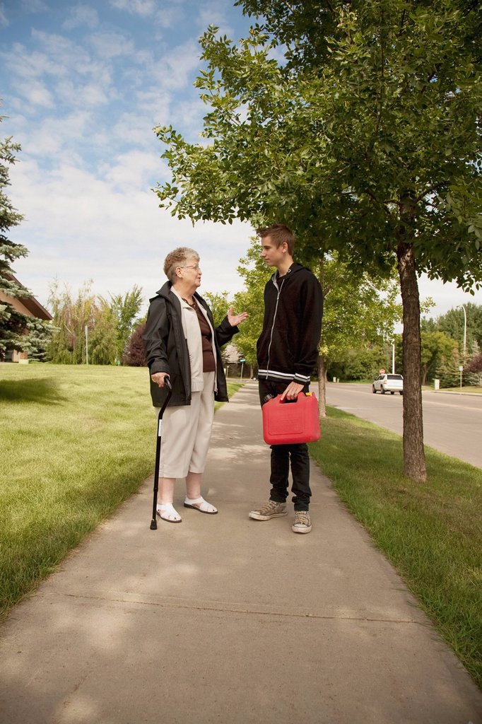 Stock Photo: 1889R-78198 a senior woman talks with a teenage boy, edmonton, alberta, canada