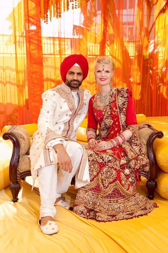 Portrait of a mixed race couple on their wedding day in traditional indian garments for a wedding, ludhiana punjab india : Stock Photo