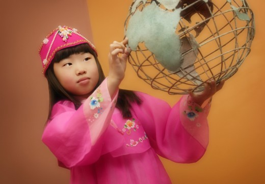 Child holding the world globe : Stock Photo