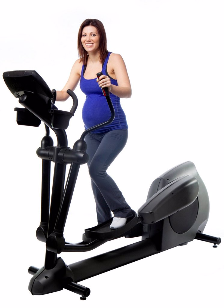 Stock Photo: 1889R-78603 A pregnant woman using fitness equipment, edmonton alberta canada