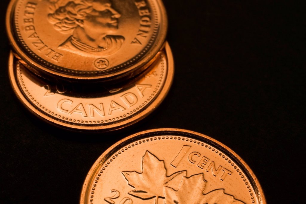 Stock Photo: 1889R-78693 Canadian pennies on a black background, quebec canada