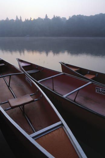 Canoes on Still Water : Stock Photo