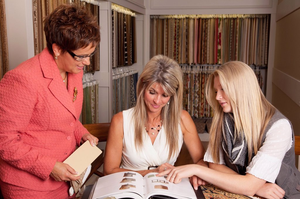 mother and daughter discussing colours and samples for remodelling of home with an interior designer, edmonton, alberta, canada : Stock Photo