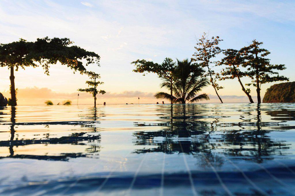 Stock Photo: 1889R-80437 Sunset at the radisson tahiti resort arue near papeete, tahiti nui french polynesia south pacific