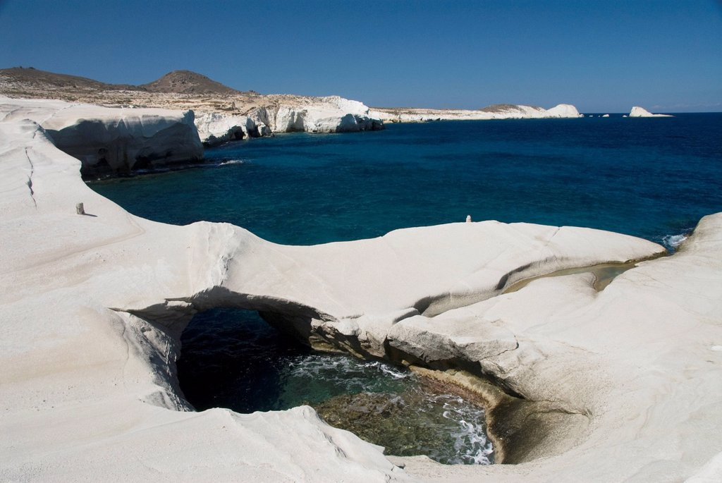 Stock Photo: 1889R-82517 Pool of water and unique rock formations along the coast, sarakiniko, island of milos, greece