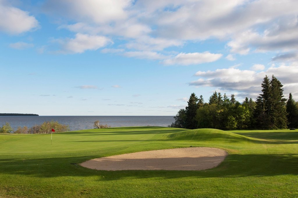 Golf course putting green and pin on lake, hecla island manitoba canada : Stock Photo