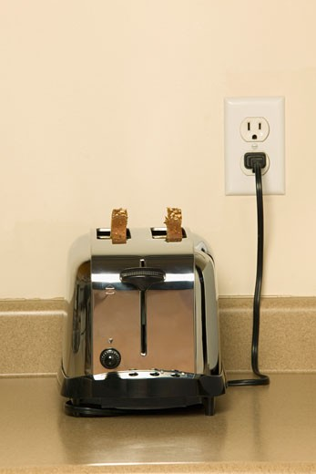 Plugged in toaster : Stock Photo