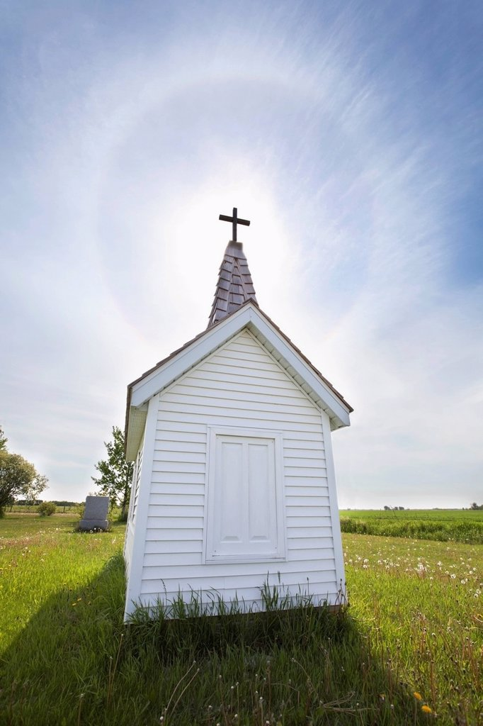 Cross On Crypt With Sun Halo Near Minnedosa, Manitoba Canada : Stock Photo