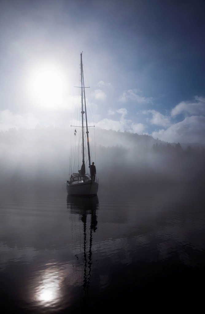 Stock Photo: 1889R-86016 A Sailboat At Anchored In The Fog In The Gulf Islands, British Columbia Canada