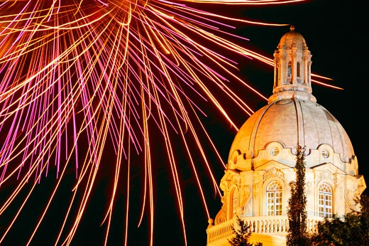 Stock Photo: 1889R-8739 Fireworks at night by the Albertan parliament building