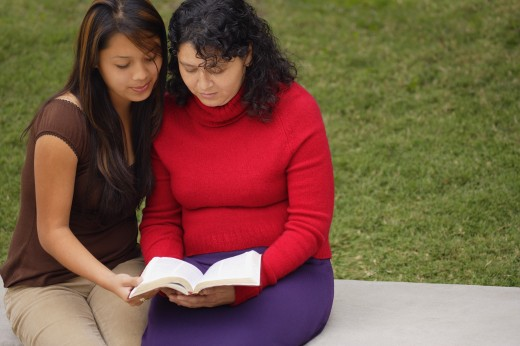 Mother and daughter reading Bible : Stock Photo