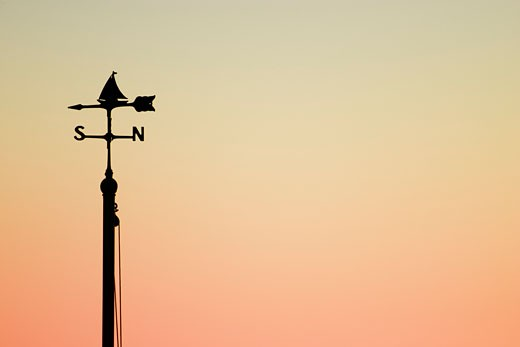 Silhouette of weather vane : Stock Photo