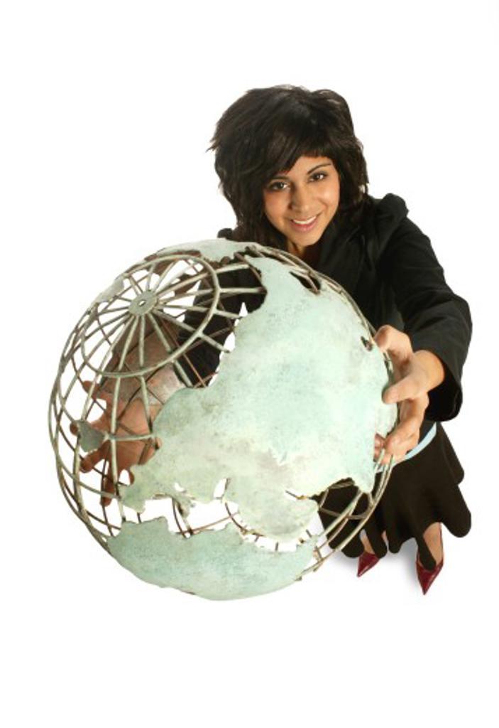 Woman holding globe : Stock Photo