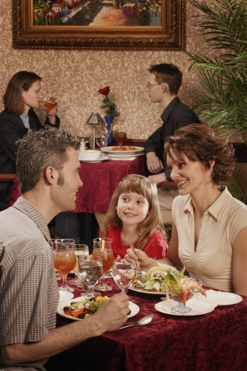 Stock Photo: 1889R-9890 Family in a restaurant