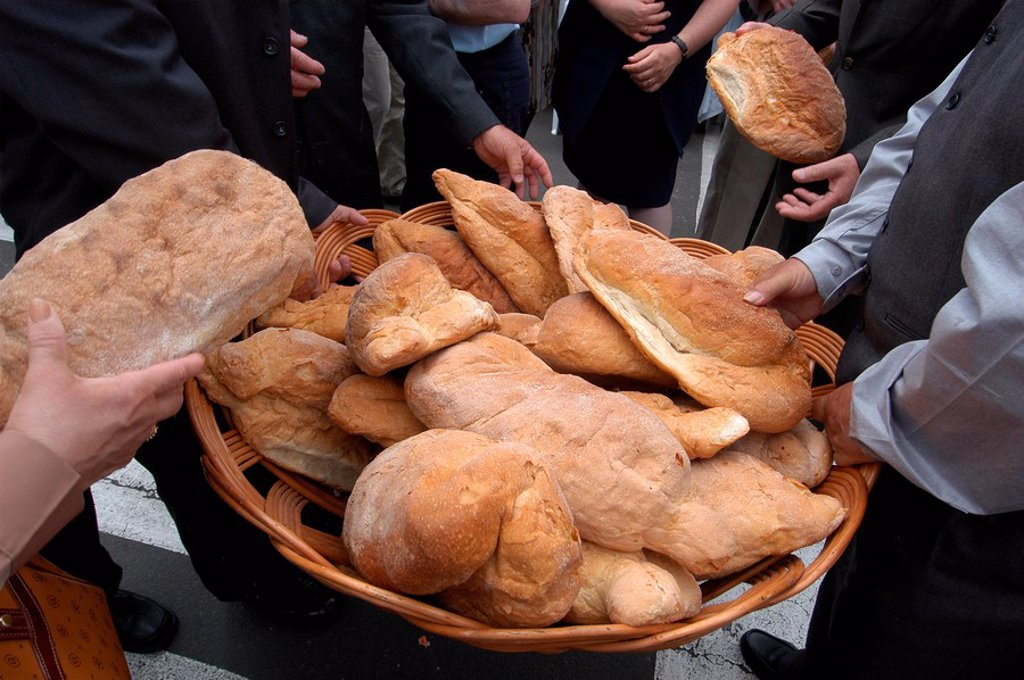Bread distribution during Espiritu Santo Festival, Vila Nova, Azores, Portugal, Europe : Stock Photo