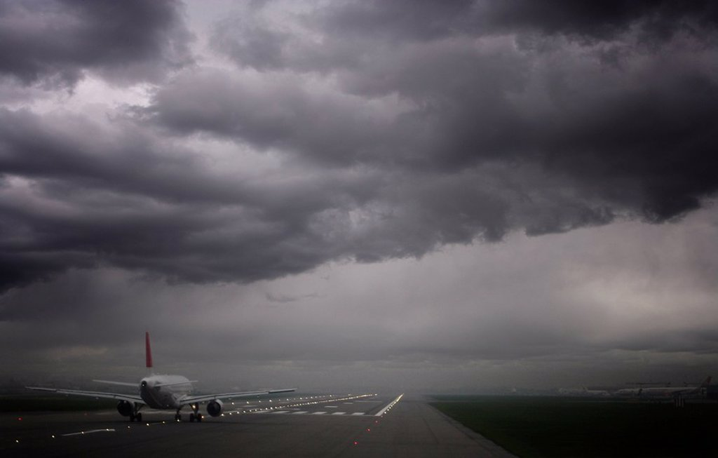 Stock Photo: 1890-104059 Plane ready for take off and stormy skies, Heathrow Airport, London, England, United Kingdom, Europe