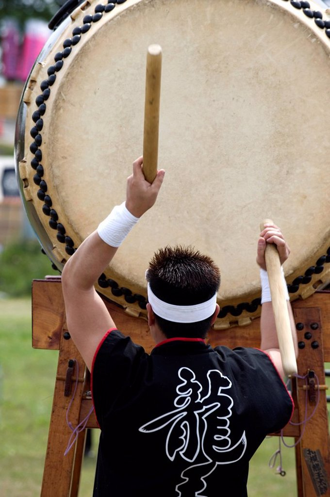 Stock Photo: 1890-105050 Drummer performing on a Japanese taiko drum at a festival in Kanagawa, Japan, Asia