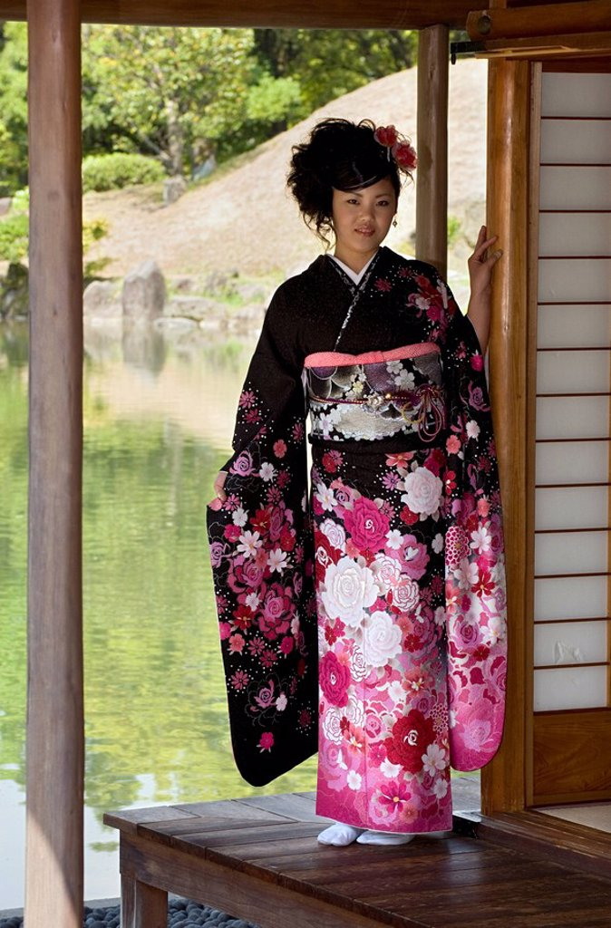 Stock Photo: 1890-105165 A 20_year old Japanese girl wearing spring furisode kimono with long sleeves to indicate her single social status, Japan, Asia