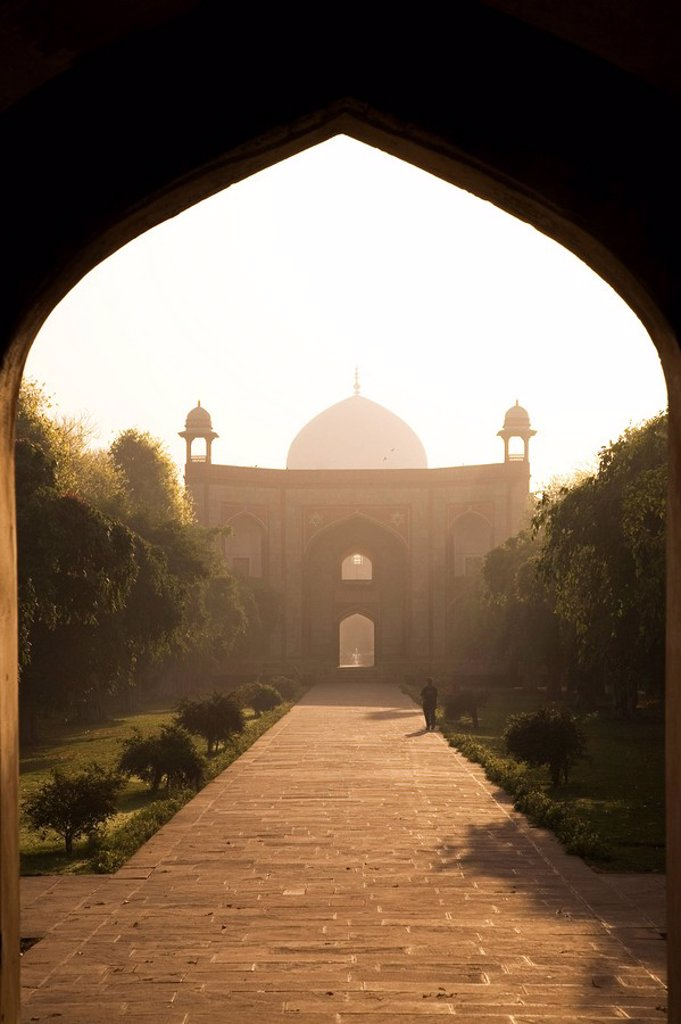 Stock Photo: 1890-105894 A man takes a morning walk in the Mughal era Humayan´s Tomb complex, UNESCO World Heritage Site, Delhi, India, Asia