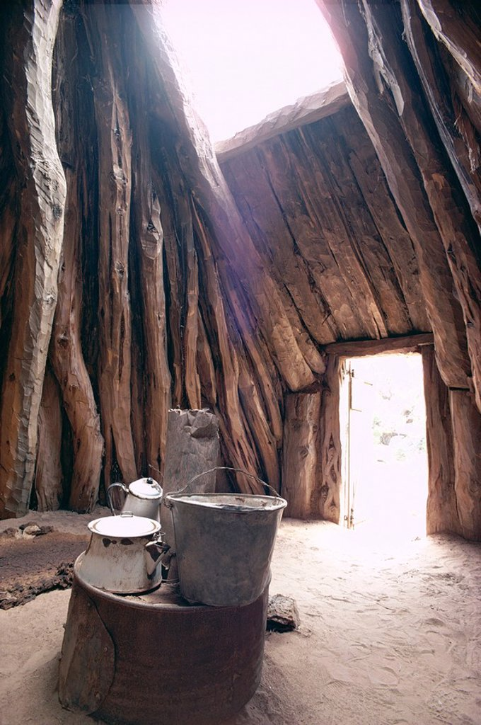 Stock Photo: 1890-10625 Smoke hole and doorway in Navaho Navajo dwelling of mud covered pinyon pine logs, Arizona, United States of America U.S.A., North America