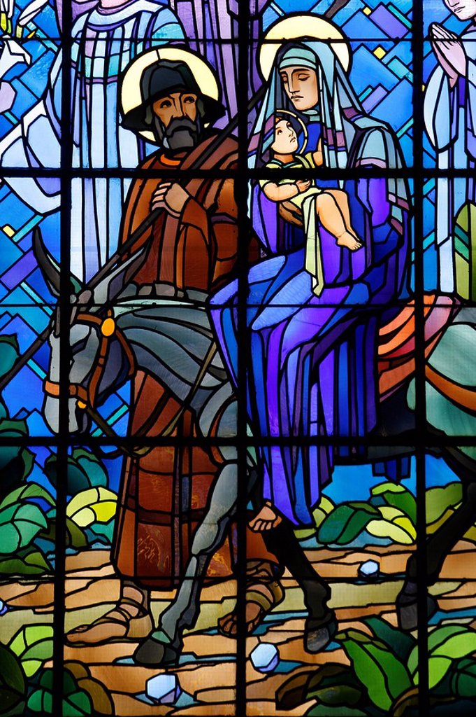 Stained glass window of the Flight into Egypt, in Chedde church, Haute Savoie, France, Europe : Stock Photo