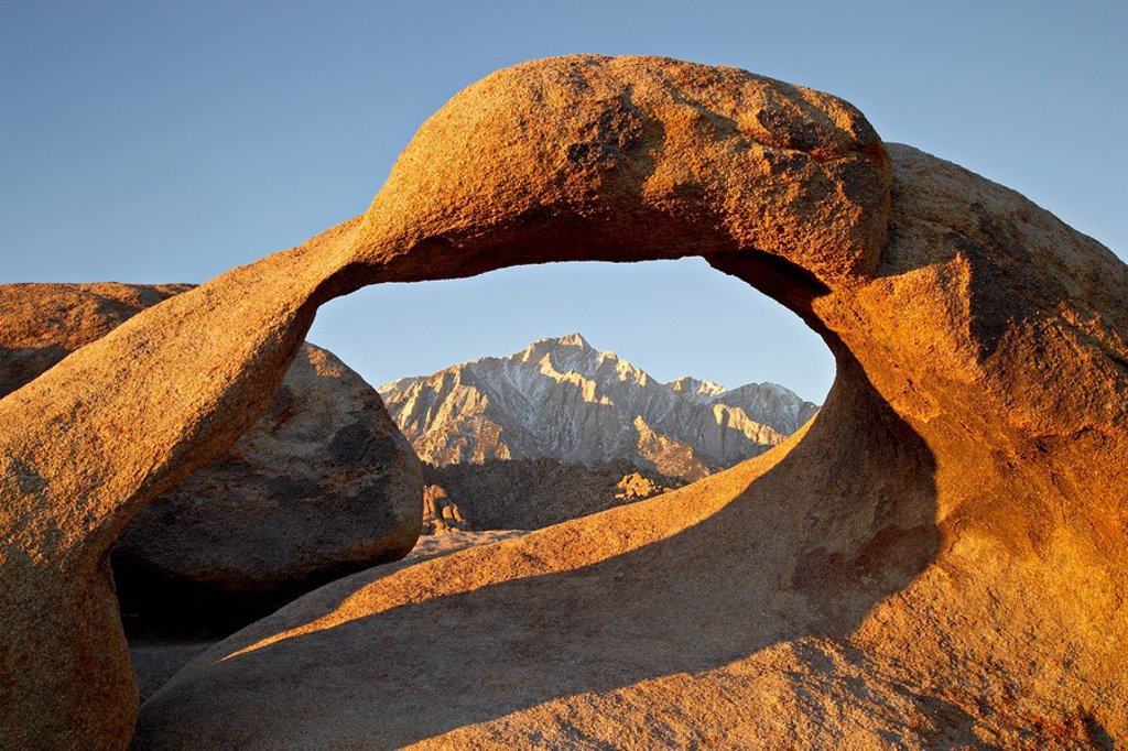 Stock Photo: 1890-109059 Mobius Arch and Eastern Sierras at dawn, Alabama Hills, Inyo National Forest, California, United States of America, North America