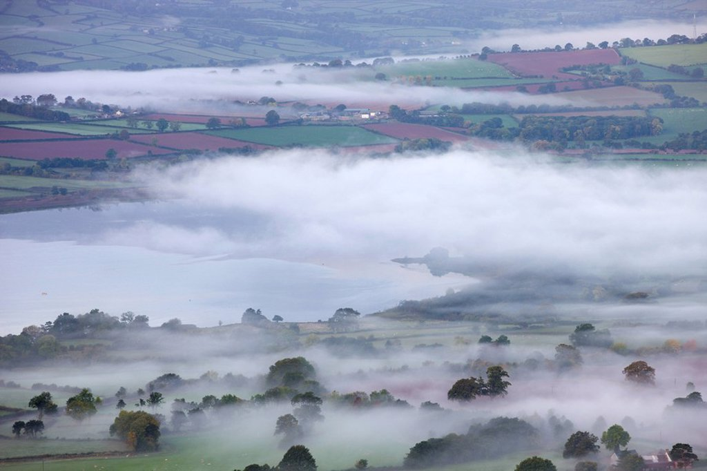 Stock Photo: 1890-109650 Mist shrouded Llangose Lake and surrounding landscape at dawn, Brecon Beacons National Park, Powys, Wales, United Kingdom, Europe