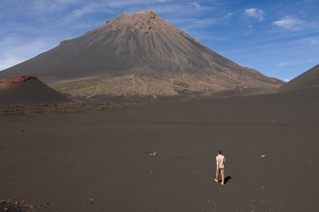 Stock Photo: 1890-109932 Man walking towards volcano on Fogo, Cape Verde Islands, Africa