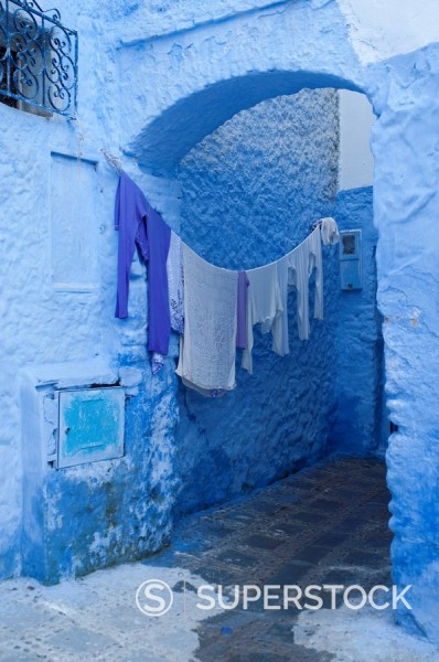Clothes drying in a typical house entrance, Chefchaouen, Morocco, North Africa, Africa : Stock Photo